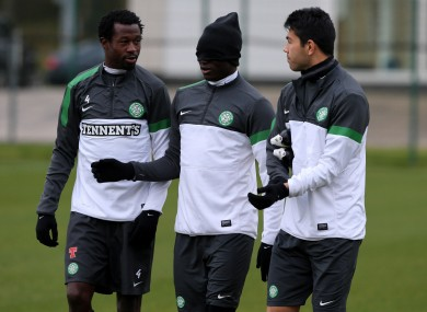 Celtic's Victor Wanyama, centre, Efe Ambrose, left,  and Miku during training.