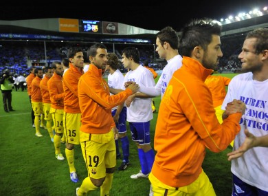 FC Barcelona's and CD Alaves players shake hands on Tuesday night.