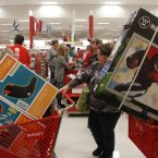 Darlene Gober leaves a store at 10 p.m. on Thursday with two cartfuls of items after saving big on Black Friday deals in Hurst, Texas. (Richard W. Rodriguez/AP Images for Target)