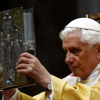 Pope Benedict XVI holds the book of the gospels during a mass in St. Peter's Basilica at the Vatican. (AP Photo/Pier Paolo Cito)