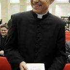 Monsignor Georg Gaenswin, Pope Benedict XVI's personal secretary, holds a copy of the Pontiff's new book. (AP Photo/Gregorio Borgia)
