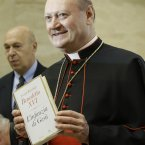 Cardinal Gianfranco Ravasi, President of the Pontifical Council for Culture, holds a copy of Pope Benedict XVI's new book. (AP Photo/Gregorio Borgia)