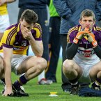 Down and out. Wexford duo Rory Quinlivan and Anthony Masterson ponder losing out against Longford in the pursuit of Division 3 league silverware. (INPHO/Cathal Noonan).