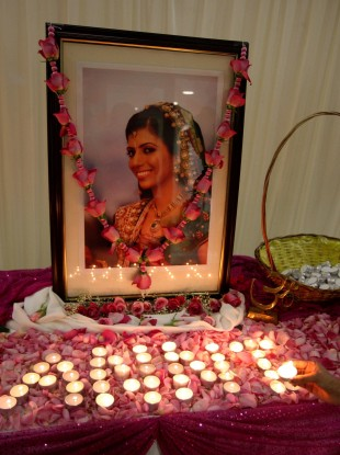 Candles are lit in memory of Anni Dewani at the Shree Kadwa Patidar Samaj in Harrow