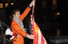 Pics: Anti-war protesters burn US flag in Dublin city centre