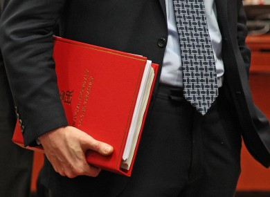 British Financial Secretary to the Treasury Greg Clark, holds his documents, during the EU finance ministers meeting, at the European Council building in Brussels