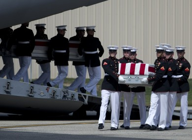 A US military carry team moves the remains of the four Americans killed in the Benghazi attack in September