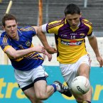 Eye on the ball. Wexford's Ciaran Lyng has Tipperary's Brian Mulvihill in close attention in their qualifier tie in Thurles. Wexford's season draws to a close as Tipperary sneak a famous win. (INPHO/Lorraine O'Sullivan).