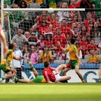 Turning point. Amidst a wave of Donegal second-half dominance, Cork come close to finding the net. Colm O'Neill, who later bags a goal in injury-time, sees his shot here cannon off the crossbar. (INPHO/James Crombie).