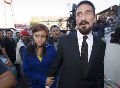 John McAfee and his girlfriend outside the Supreme Court in Guatemala City yesterday.