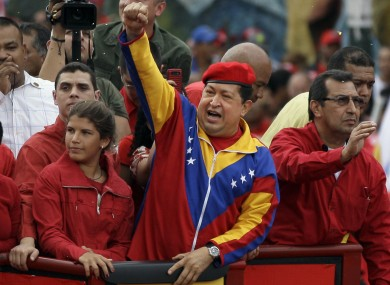 Hugo Chavez waves to a crowd in Caracas earlier this year