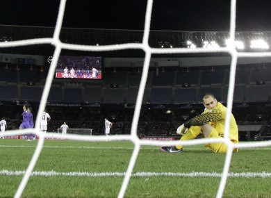 New Zealand's Auckland City FC's goalkeeper Tamati Williams, right, reacts after Japan's Sanfrecce Hiroshima's scored a goal during their match at the Club World Cup soccer tournament.