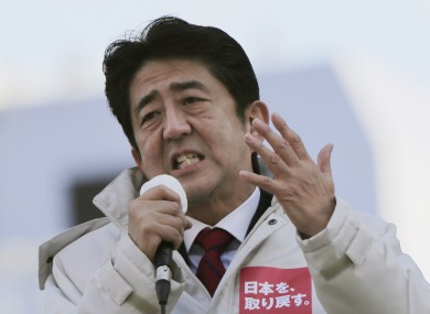 Shinzo Abe will be Japan's next prime minister, after winning a massive majority in parliamentary elections.