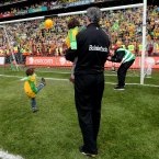 Father and son. The dust has barely settled on his marvellous achievement of managing Donegal to All-Ireland glory. Jim McGuinness is able to bask in the glow of that success as he watches his son Mark Anthony kick a point into the Davin End. (INPHO/James Crombie).