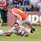 Striving for glory. Tyrone's Colm Cavanagh reaches for the ball ahead of Armagh's Kieran Toner at the the Athletic Grounds. (Russell Pritchard/Presseye).