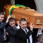 Páidí Ó Sé's remains are carried from the church by his son Pádraig Óg and nephews Fergal, Tomás and Darragh.