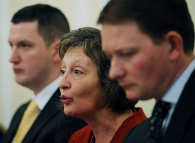 Geraldine Finucane (centre) and her two sons Michael (right) and John (left) at a press conference in Westminster today.