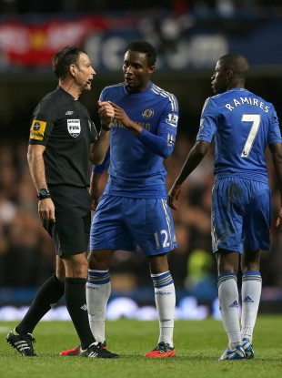 Mikel (centre) arguing with referee Mark Clattenburg.