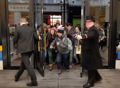 Run! Shoppers rush to pick up some bargains at the Stephen's Day sales in Dublin on Wednesday