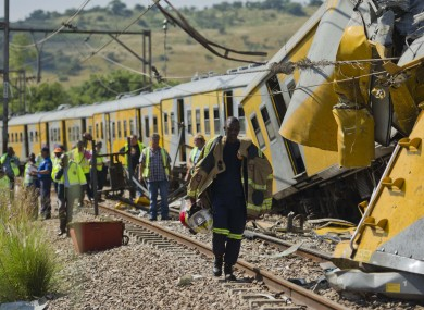 Emergency workers attend the scene of a collision between two trains near Pretoria.