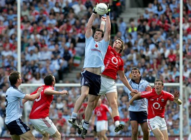Cork's Aidan Walsh and Dublin's Michael Darragh MacAuley.
