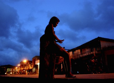 File picture: A prostitute waits for clients at a street in Abaetetuba, Brazil.
