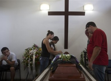 People attend the funeral of Gustavo Goncalves, a victim of the Kiss nightclub fatal fire.