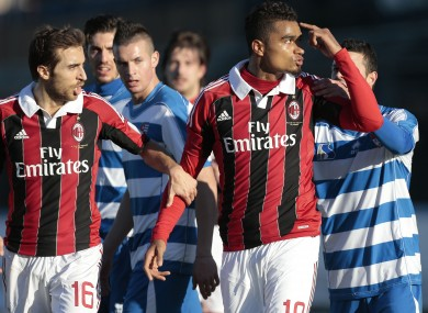 C Milan Ghana midfielder Kevin-Prince Boateng, right, is flanked by his teammate Mathieu Flamini as he gestures towards the crowd in Busto Arsizio yesterday.