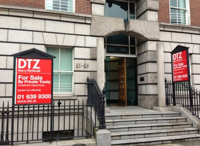 For Sale signs installed outside the building where Fianna Fáil HQ is based this morning.