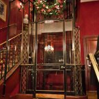 Inside, the building is more ornate. A glass French lift takes guests to the second floor. (Pete Hottelet/Flickr)