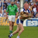 On route to winning a Munster hurling medal and shooting 0-3, John Mullane found time in Thurles to clear the pitch of a canine invasion.