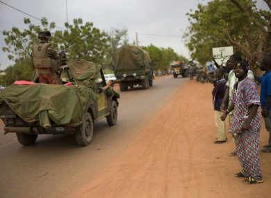 Malian people welcome French soldiers as they arrive in the city of Sevare yesterday
