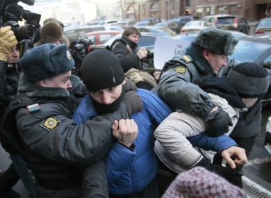 Police detain supporters of a bill banning