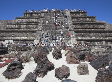 A file photo of tourists on a pyramid at Teotihuacan, an old city-state in Mexico near where the skulls were found.