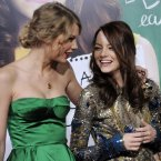 TAYLOR SWIFT AND EMMA STONE:  What the?  What?!?  We're as surprised as you are.  Taylor even introduced Harry Styles to the person she says is