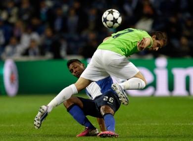 FC Porto's Alex Sandro tussels with Malaga's Joaquin Sanchez.