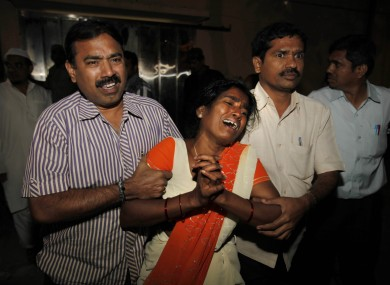 An Indian woman Sujatha, wails after seeing her husband Venkateshwarulu's body, unseen, killed in bomb blast,