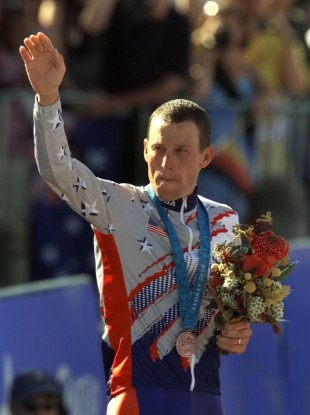 Lance Armstrong waving after receiving the bronze medal in the men's individual time trials at the 2000 Summer Olympics.