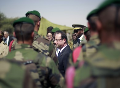 French President Francois Hollande addresses the troops at the airport following his two-hour-long visit to Timbuktu, Mali.