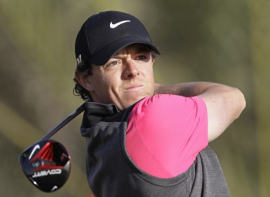 Rory McIlroy from Northern Ireland tees off on the 14th hole during the first round of Abu Dhabi Golf Championship in Abu Dhabi.