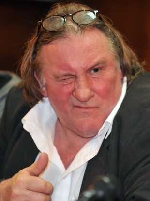 French actor Gerard Depardieu gestures during a press conference with Montenegro Prime Minister Milo Djukanovic