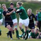 Niamh Briggs hands off Lisa Ritchie of Scotland.  ©INPHO/Dan Sheridan