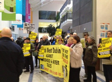 Demonstrators against property taxes and water charges protest at South Dublin County Council's monthly meeting in Tallaght.