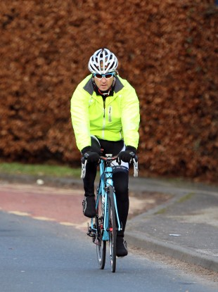 Man City boss Roberto Mancini cycles home from training yesterday.