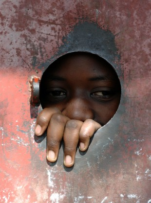 A child living in one of Kampala's many outlying slum settlements, Uganda.