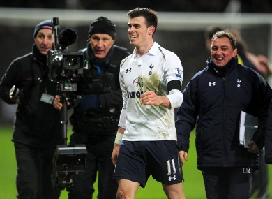 Tottenham Hotspur's Gareth Bale celebrates as he leaves the pitch after the final whistle.