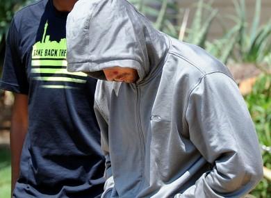 Olympic athlete Oscar Pistorius leaves the Boschkop police station, east of Pretoria,