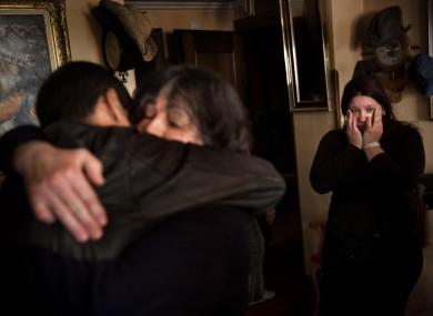 A Madrid family reacts when they hear their eviction has been suspended earlier this month