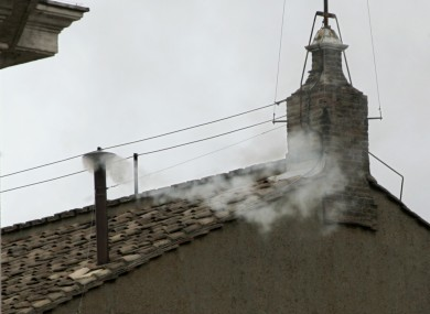 White smoke emerges from the chimney of the Sistine Chapel, indicating a successful outcome to the Papal Conclave of 2005.