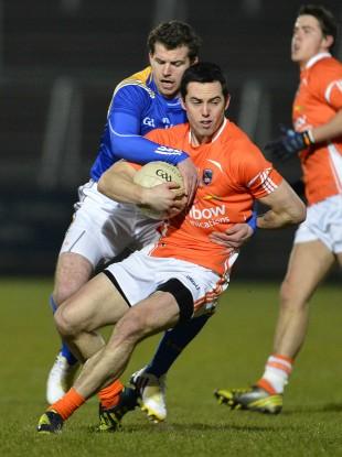 Armagh's Aaron Kernan and Longford's Aidan Rowan in action on Saturday evening.